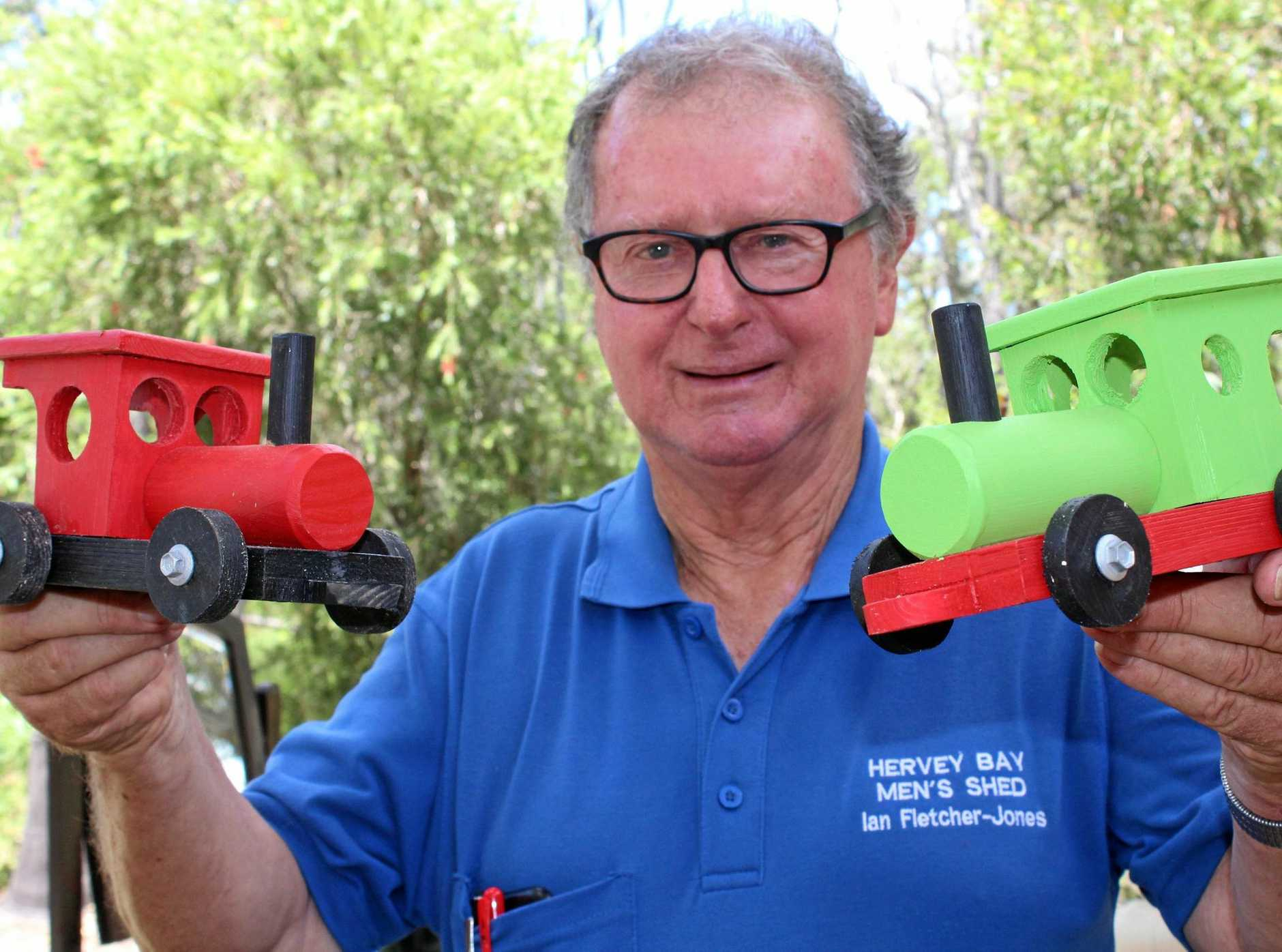 TOOT TOOT: Hervey Bay Men's Shed president Ian Jones is hoping these super cute children's trains will entice baragin hunters to the group's garage sale this weekend.