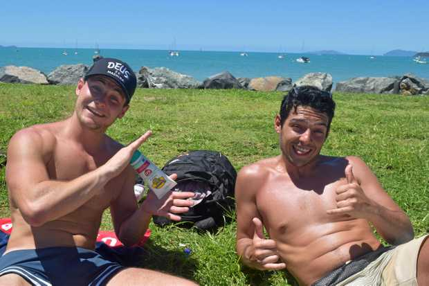 Thomas Edla and Axel Moreau relaxing by the Airlie Beach lagoon.