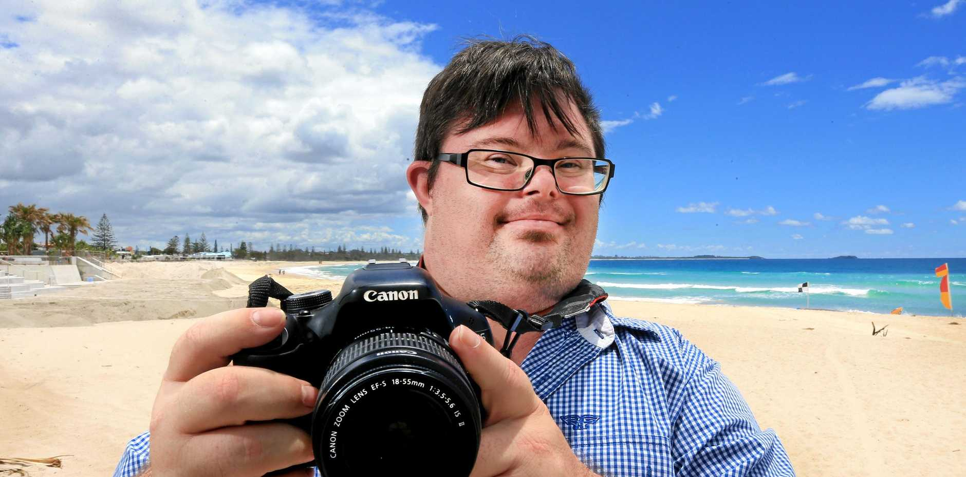 SAY CHEESE: Kingscliff resident Tim Morrissey, who has Down Syndrome, has started his own photography business.