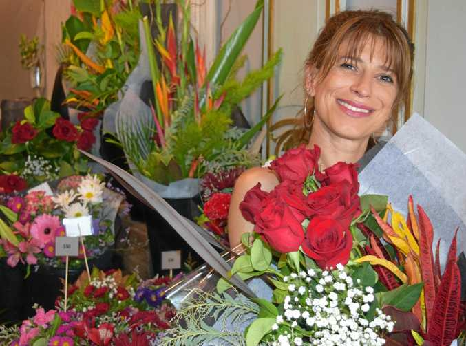 VALENTINE: Jan Jones, of Branch and Blossom in Mary Street says sleep is over-rated, partly because she has forgotten what it is like in the shop's busy lead-up to today's big event for lovers - Valentines Day.