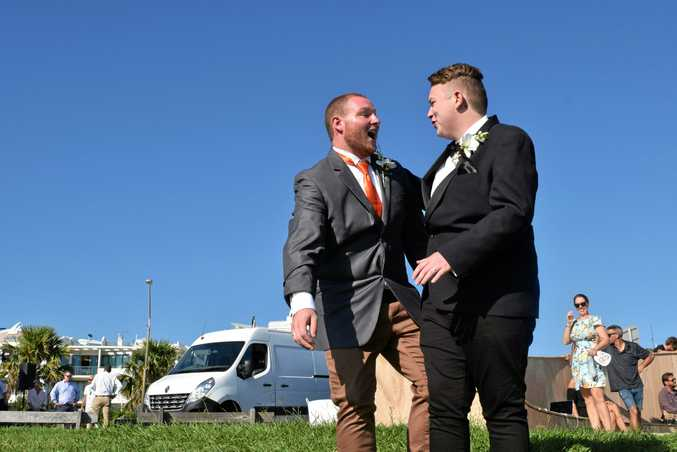 HAPPILY MARRIED: Two same-sex Coast couples were married at Alex Bluff Park today. Pictured: Wayne and Jordan Paluszkiewicz.