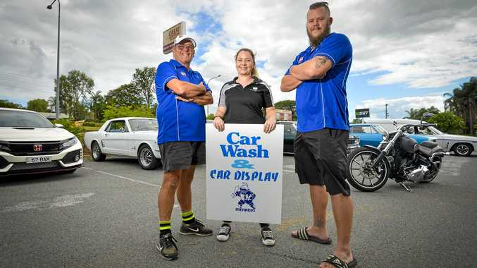 WORKING AT THE CAR WASH: Graeme Huther with Rocky Glen general manager Aoibheamn Moynihan and Valleys' player 'Trotter'.