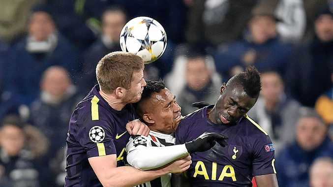 Juventus' Alex Sandro, centre, is sandwiched by his Tottenham Hotspur rivals.