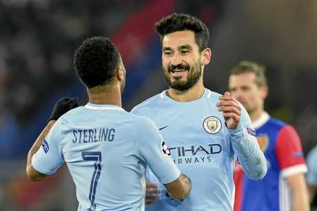 Manchester City's Ilkay Gundogan, right, celebrates with Raheem Sterling.