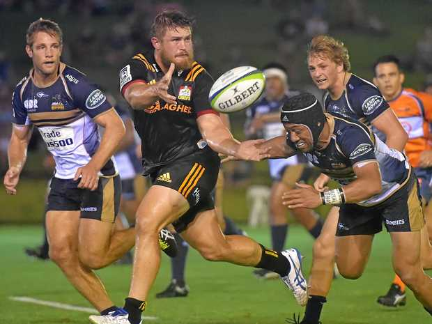 TOO GOOD: Liam Polwart gets a pass away during the Chiefs victory over the Brumbies at Bokarina last night.