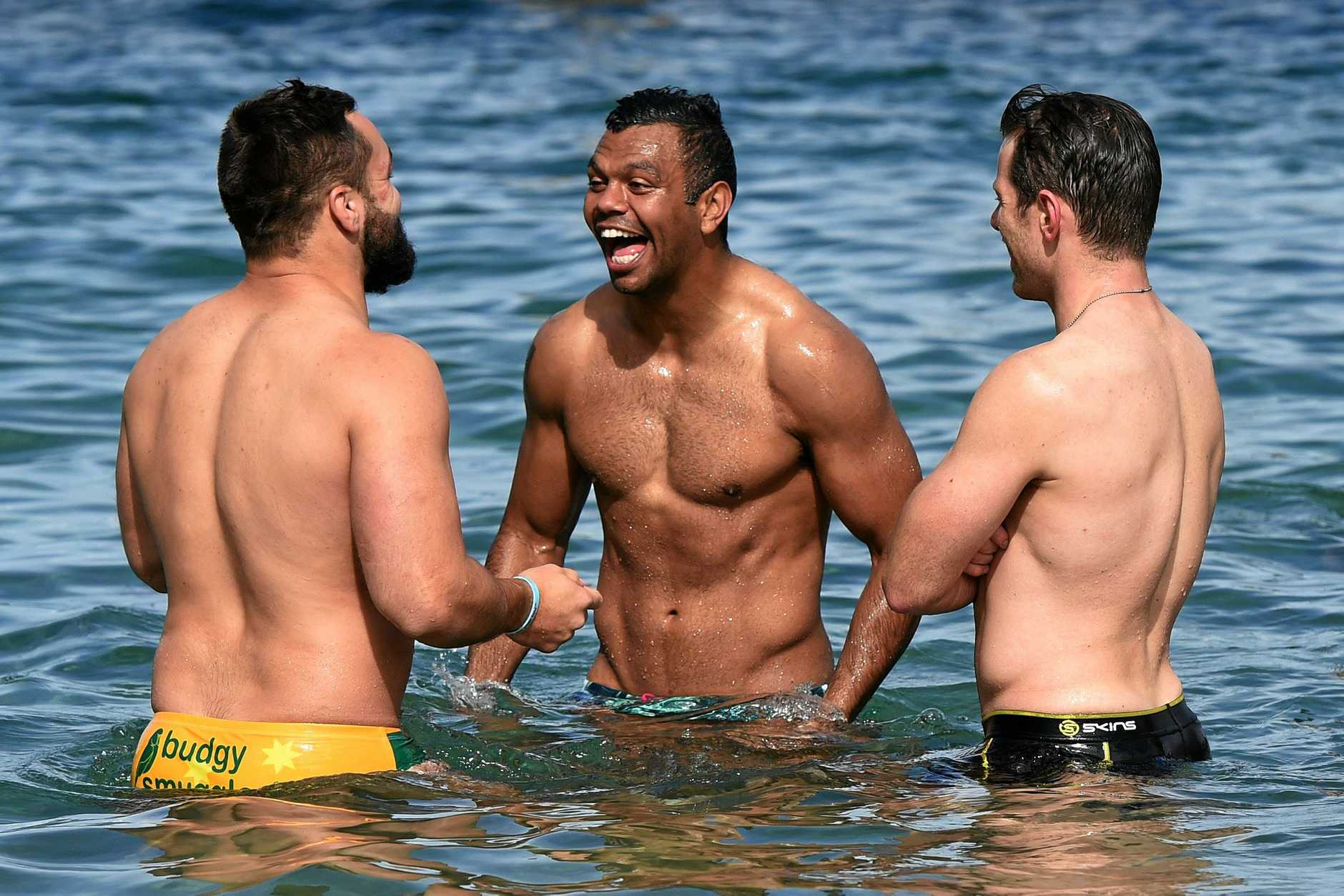 Wallabies player Kurtley Beale (Centre) has a laugh as he cools down following their final training session at Little Manly Beach in Sydney, Friday, Aug. 28, 2015. The Wallabies fly out tomorrow for the Rugby World Cup in England. (AAP Image/Dean Lewins) NO ARCHIVING