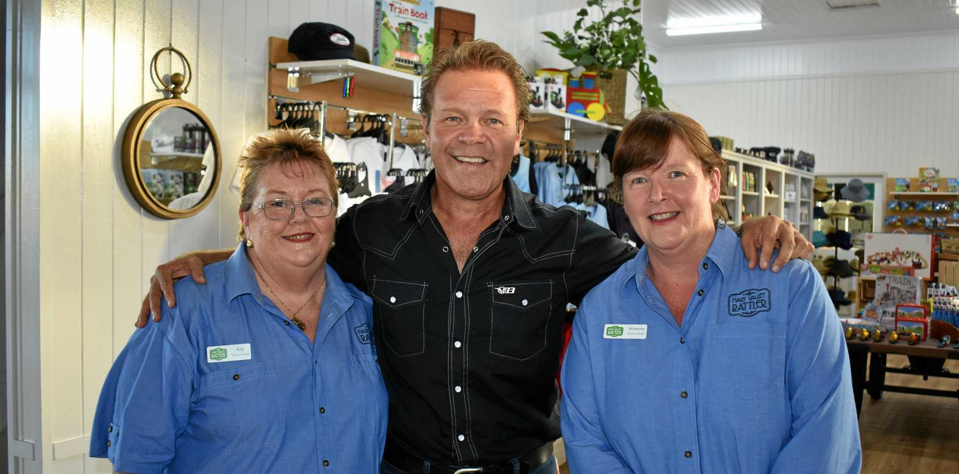 Rattler volunteers Kay Buckley (left) and Maxene Grewar with new Muster ambassador and recording artist Troy Cassar-Daley at the official 2018 Gympie Music Muster launch on Tuesday at the old Gympie station.