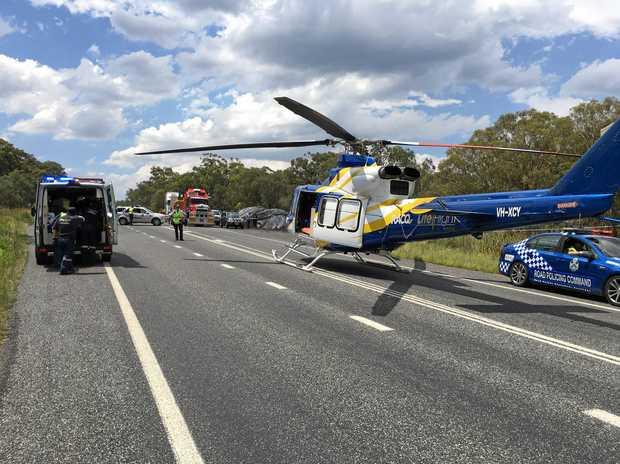 THREE-VEHICLE CRASH: Trucks collided on the New England Highway.