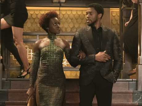 "Lupita Nyong'o and her ""easy on the eye"" co-star Chadwick Boseman in a scene from Black Panther."