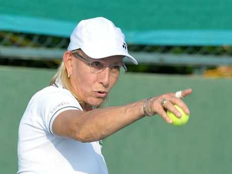 Martina Navratilova was duped too. AFP PHOTO / NOAH SEELAM