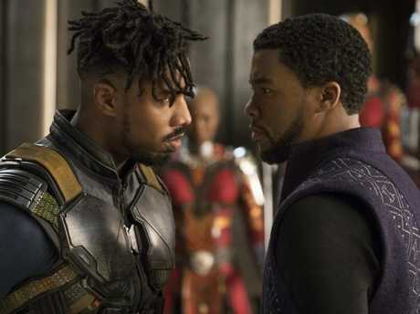Michael B. Jordan's Killmonger and Chadwick Boseman's T'Challa face off in a scene from Black Panther.