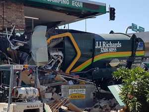 Driver dies after truck smashes into store