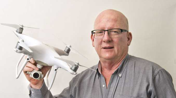 The Chronicle photographer Neville Madsen with the newspapers' DJI Phantom drone.
