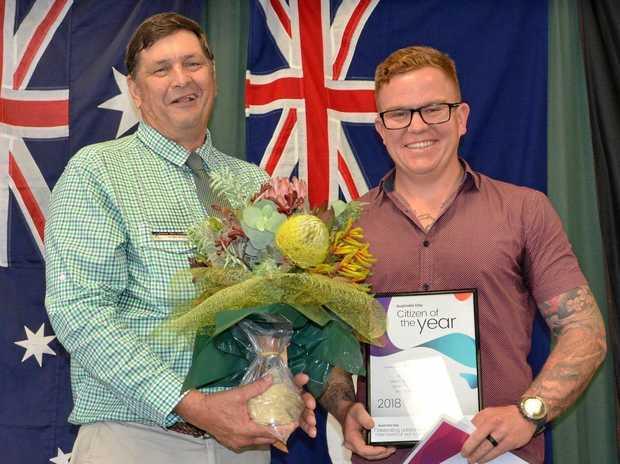HONOUR: Banana Shire Mayor Nev Ferrier congratulates 2018 Citizen of the Year Brendan Beahan.