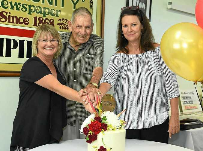 MILESTONE:  The Gympie Times  General Manager Tracey McKean , former long-term employee Jim Saunders and Editor Shelley Strachan cut the delicious 150th anniversary white chocolate mud cake yesterday made by Jessie & Co, the flowers by Branch & Blossom.