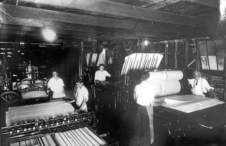 The Printing Department of the Gympie Times in the early 1930s On the left is the folding machine being operated by Harold Solomon and Reg Stolberg. On the right is the Wharfdale Flatbed Cylinder Press printing The Gympie Times under supervision of Jim Milne (production Foreman, far right) assisted by Hugh Murphy and Dave Router.
