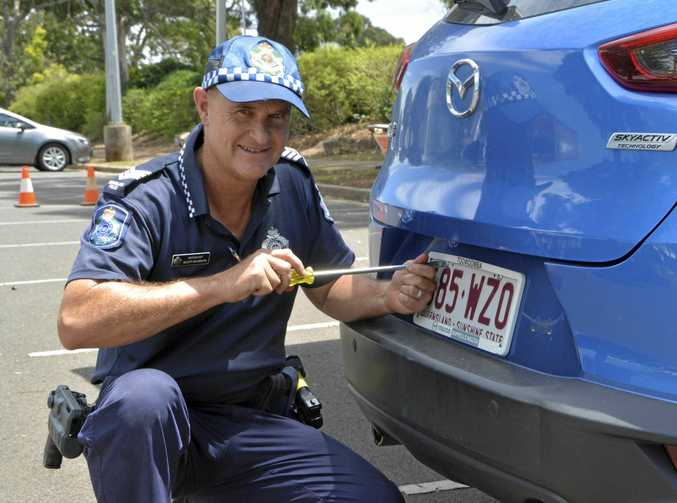 KEYED IN: Toowoomba Crime Prevention Unit Sergeant Scott McGrath shows how to use the one-way screws.