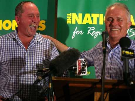 PM Malcolm Turnbull joins Barnaby Joyce, celebrates on stage his win in the New England by-election. Picture: Lyndon Mechielsen