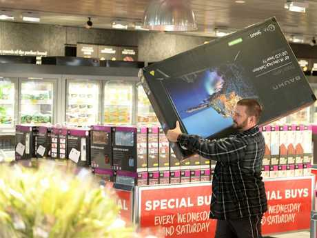 A customer in Perth gets ready to purchase one of the hottest Aldi Special Buys.