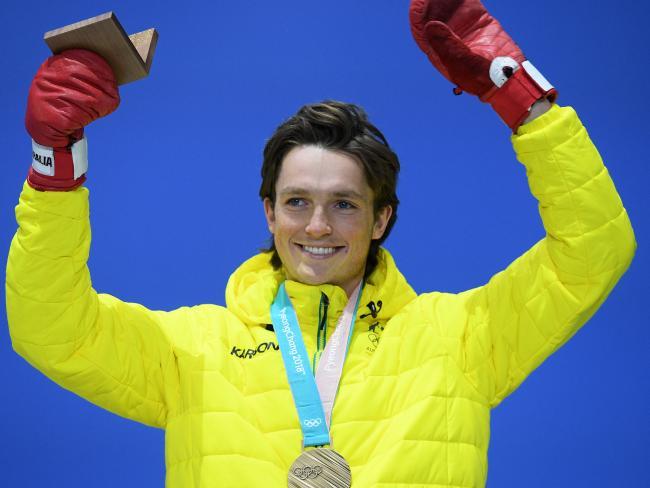 Scotty James of Australia receives the bronze medal
