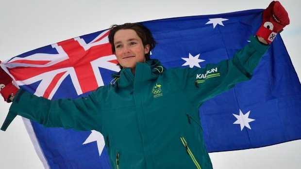 Australia's Scotty James celebrates on the podium during the victory ceremony after the final of the men's snowboard halfpipe at the Phoenix Park during the PyeongChang 2018 Winter Olympic Games on February 14, 2018 in PyeongChang. / AFP PHOTO / Martin BUREAU