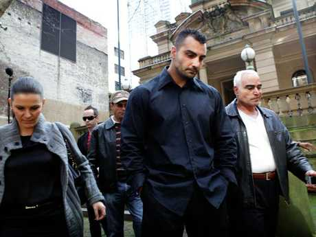 Bikie Mick Hawi arrives court with his father to face charges over the death of Hells Angels associate Anthony Zervas.