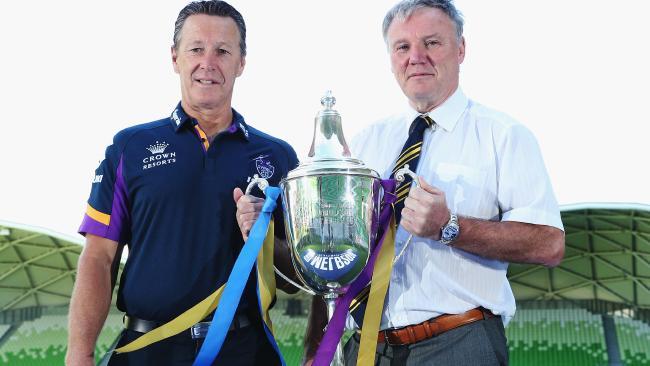 Craig Bellamy and Leeds Rhinos CEO Gary Hetherington pose with the World Club Challenge trophy.