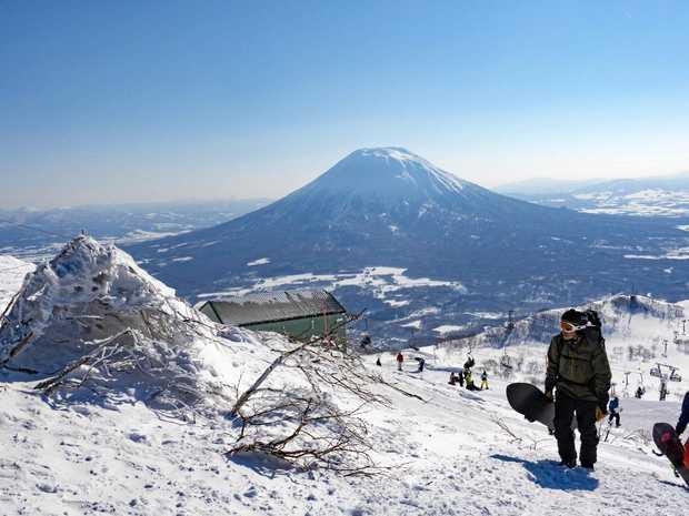 Niseko, Hokkaido, Japan - February 27, 2016: Snowboarders Hike up the Backcountry Trail at Mt Annupuri, Part of the Niseko United Ski Resort