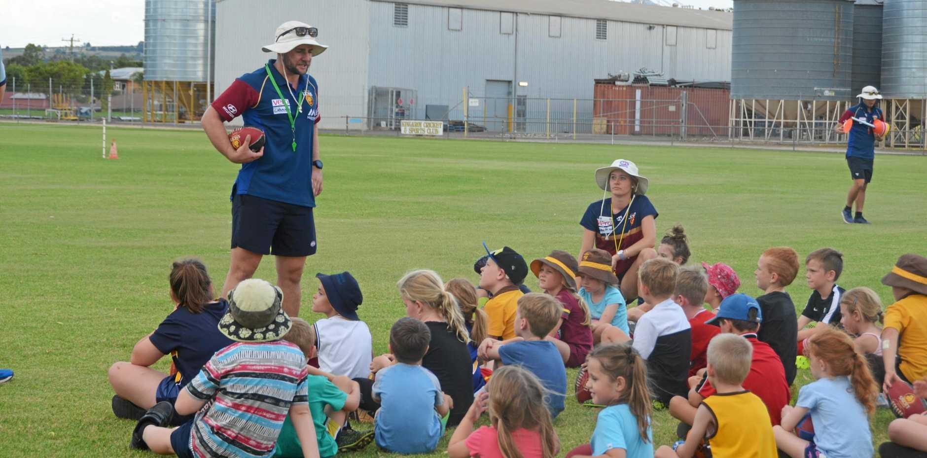 Kids listen to instructions at Auskick in Kingaroy.