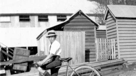 Jim Grimes riding a bicycle to school. Nambour, ca 1920.