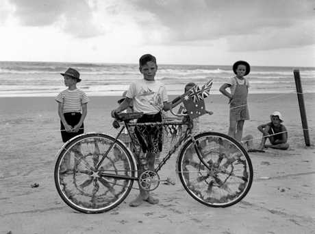 Decorated bicycle competition at Coolum Beach, 1950. Decorated bicycles and sand garden competitions were among the popular events held at beaches across the Sunshine Coast during holiday season.
