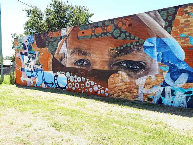 FAMOUS FACE: Murgon mural by artists Kane Brunjes and Bronte Naylor.