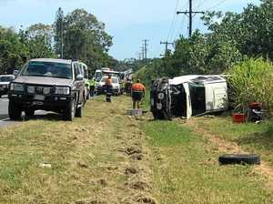 Ute a crumpled wreck after rolling on busy road