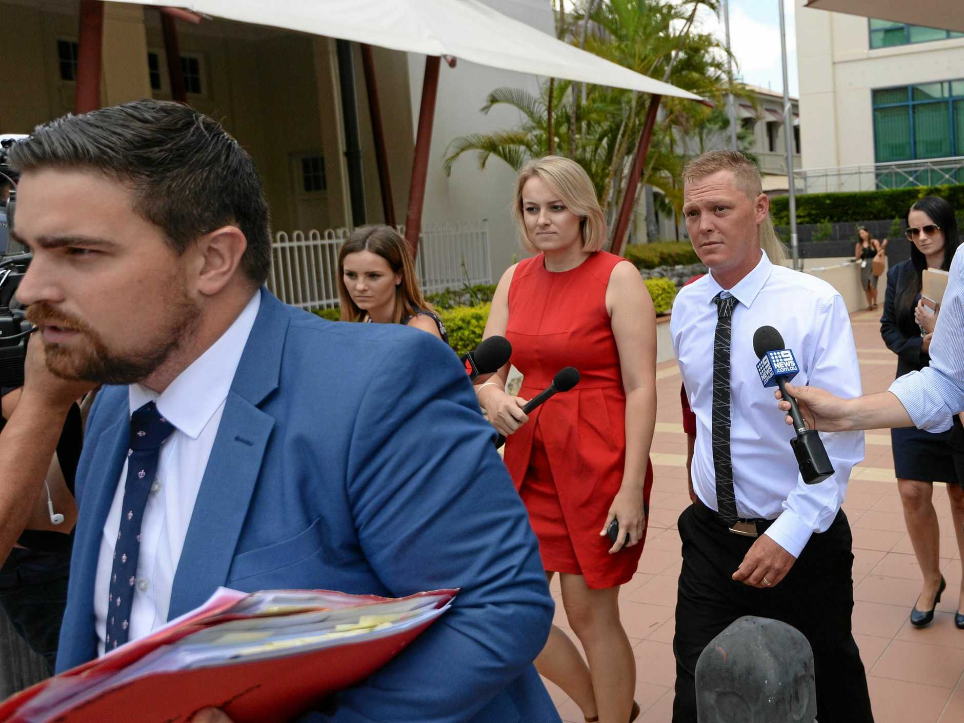 Solicitor Rowan King (front) with Luke Stephen Orchard as they leave Rockhampton Court.