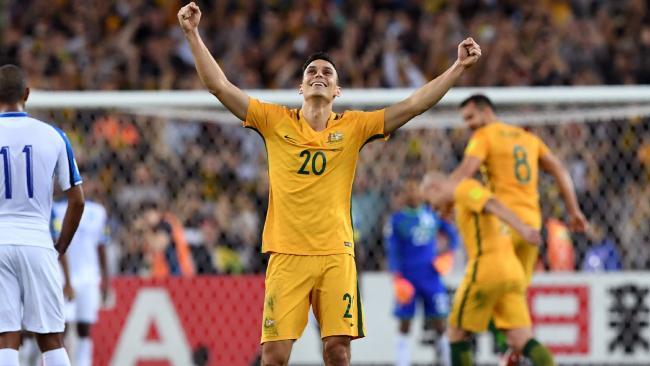 Australia's Trent Sainsbury celebrates.