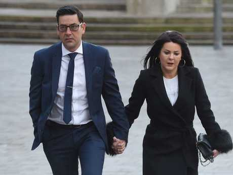 Former footballer and victim of abuse Andy Woodward (L) arrives at court with his partner Zelda in Liverpool on the first day of the trial of former football coach Barry Bennell.