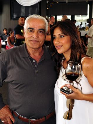 Hawi's glamorous wife Carolina and his father Ahmad.