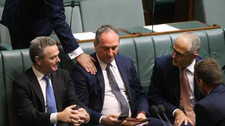 Christopher Pyne and Prime Minister Malcolm Turnbull console Deputy PM Barnaby Joyce yesterday. Picture Kym Smith