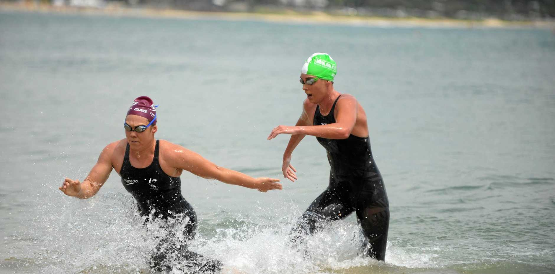 Chelsea Gubecka (left) stumbles after standing in the shallows, but still managed to get the win six seconds in front of Kareena Lee.