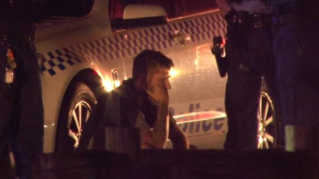 Accused driver Jakob Thornton sits beside a police car after Friday night's incident. Picture: TNV