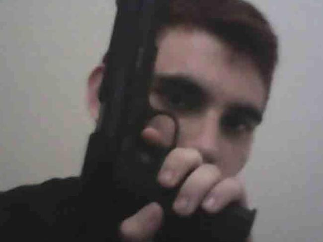 The suspected Florida high school gunman flashes a gun in a selfie on his now deleted Instagram page. Picture: Twitter