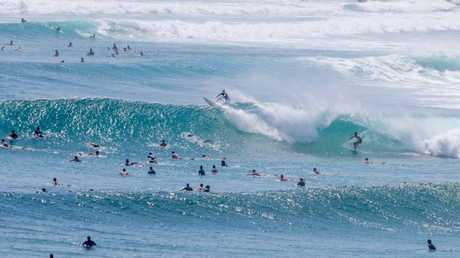 Surfers hit Snapper Rocks this morning as swells of up to three metres are expected. Picture: Luke Marsden
