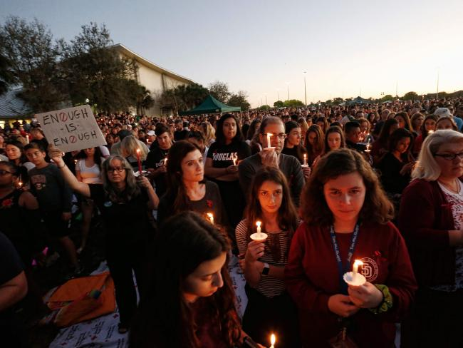 Thousands of mourners attended a candlelight vigil for victims of the Marjory Stoneman Douglas High School shooting in Parkland, Florida. Picture: AFP