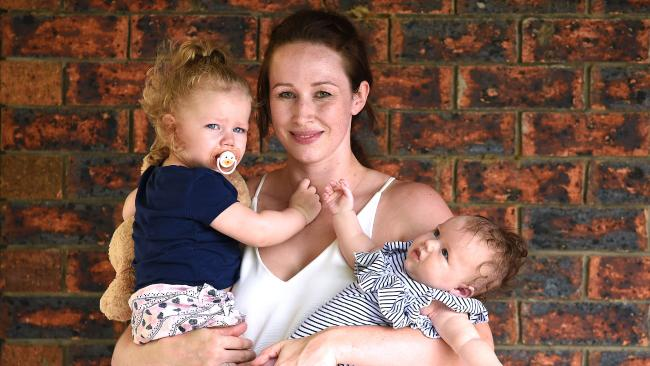 Jessica Marsden – with daughters Evelyn and Holly – saved money by buying second-hand goods. Picture: AAP/John Gass