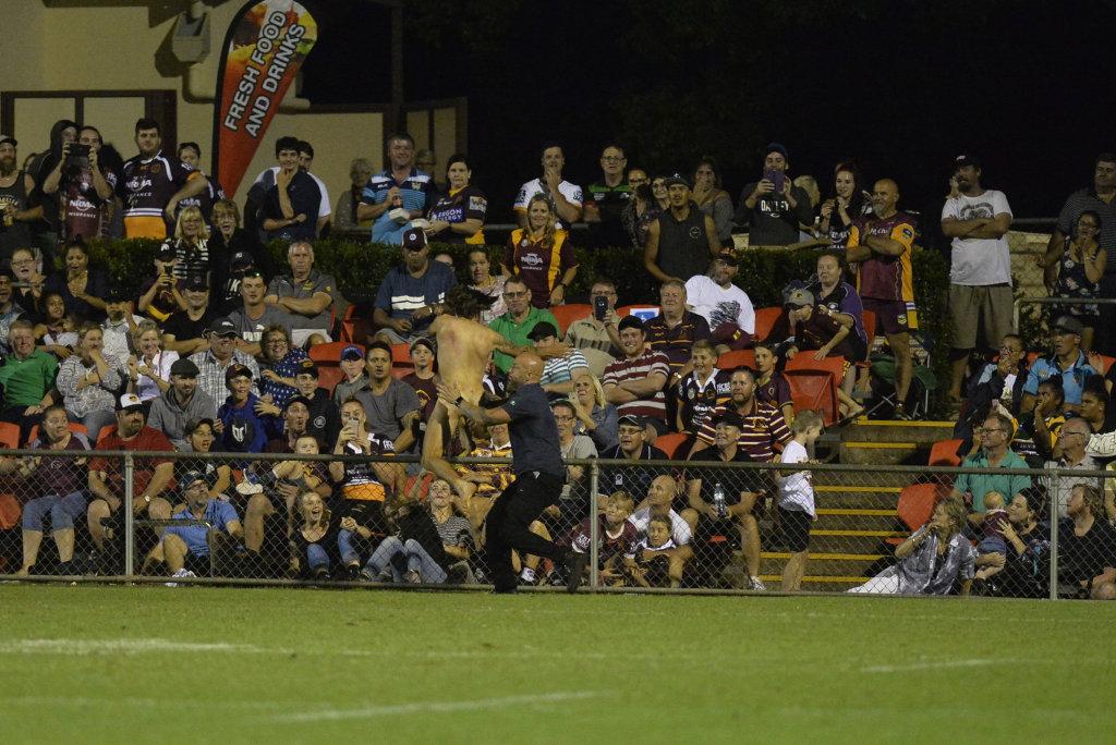 A streaker on the field at the Brisbane Broncos v Gold Coast Titans NRL pre-season trial at Clive Berghofer Stadium.