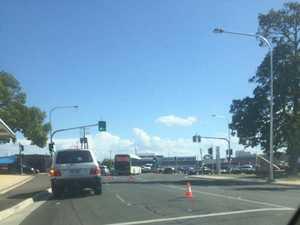 Broken-down bus blocks traffic at intersection