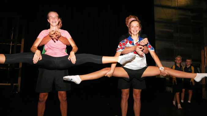 ON STAGE: Aiden Taha and Byron Muller give Tahlia Skinner and Flo Matthews a lift during rehearsal for Footloose.
