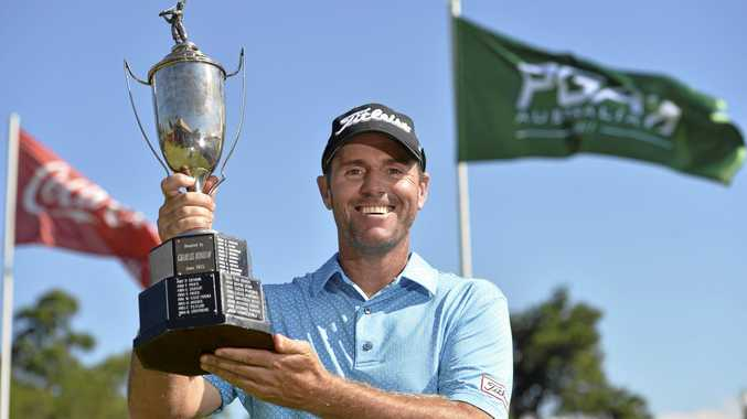 West Australian Daniel Fox with the Charles Bonham trophy after his Queensland PGA Championship victory today at City Golf Club.