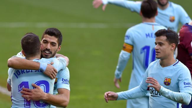 Barcelona's Uruguayan forward Luis Suarez (2L) congratulates Barcelona's Spanish defender Jordi Alba (L)