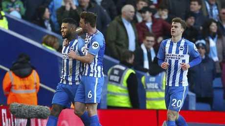 Brighton & Hove Albion's Jurgen Locadia, left, celebrates opening his account for the club